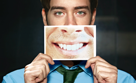 dca-blog_dental-implant-man-with-picture